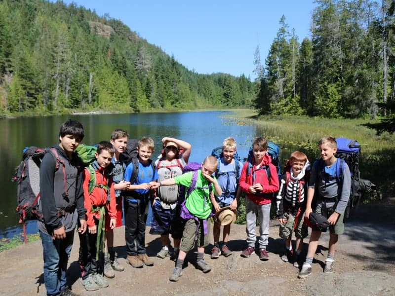 hike group with lake
